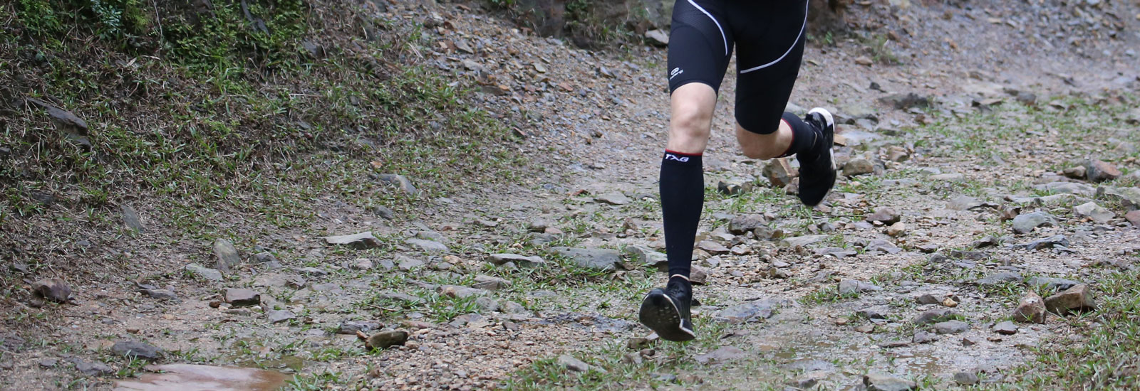 Male runner wearing TXG Calf Sleeves