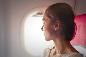 woman sitting beside the airplane window