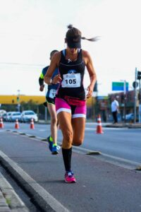 lady runner wearing compression socks